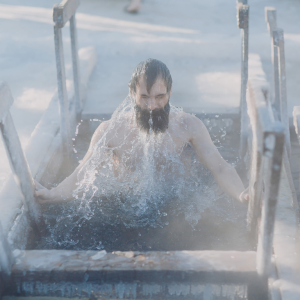 Man Coming Out Of Ice Cold Water